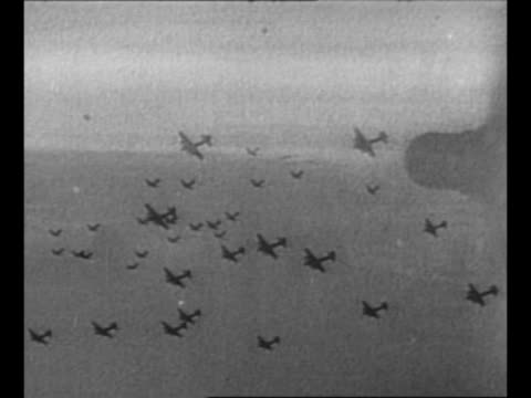 Montage B17 'Flying Fortress' planes fly including planes leaving contrails planes in formation POVs planes from camera plane planes flying above...