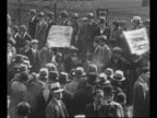 Montage black and white workers march peacefully with signs as spectators watch / marchers pass White House / rear shot marchers / WS Park Police...