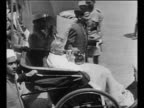 Montage crowds of people in Simla where discussion of India's future is to be held / Mohandas Gandhi arrives in carriage pushed by man as another man...