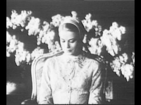 [4/18/1956] Montage Grace Kelly and Prince Rainier enter the Throne Room at the Prince's Palace of Monaco for the civil ceremony portion of their...