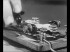 Montage CU hand taps message on telegraph key / WS aerial ship in water with lifeboats in water barely visible / Andrea Doria lists in water /...