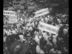 Montage INT Philadelphia's Convention Hall at the 1948 Democratic National Convention with signs delegates / WS man in Indian costume and headdress...
