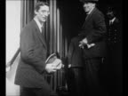 Montage Irish Sinn Fein delegation arrives in London to negotiate peace with England / politician Eamon de Valera enters building with others / Irish...