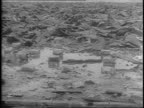 Montage of aerials of flattened Hiroshima rubble and ruins from ground level