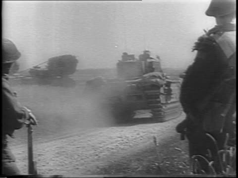 Montage of Allied tanks moving through fields / Allied tank moving away from camera soldiers in foreground / map of France showing Allied advancement...