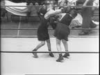 Montage of coach Spike Webb talking to group of young boys / crowd in stands / montage of two young boys Billy Clark and Jolly Mulgrew boxing in ring...
