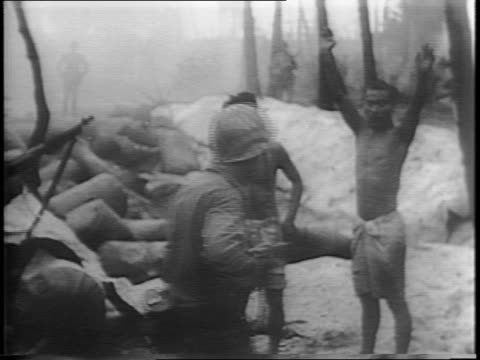 Montage of Japanese prisoners being stripped and blindfolded before questioning Japanese prisoners being questioned / Japanese prisoner with arm in...