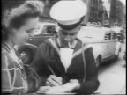 Montage of New York Street scene Flat Iron Building visible in background in a living room Minute Man selling war bonds to family woman puts war...