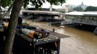 Montage of several scenes of Seine river flooding in Paris France