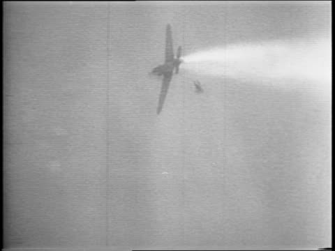 Montage of US Army Air Force and German Luftwaffe planes fighting over a battlefield Nazi jet propelled plane is shot down pilot ejecting and...