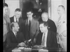 photo op Tennessee Valley Authority power director David E Lilienthal and Wendell Willkie president of Commonwealth Southern Corp examine documents...