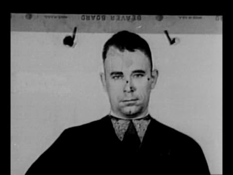 Montage police officers in Cleveland OH use a photo of John Dillinger for target practice / montage EXT buildings in Tucson AZ / police and federal...