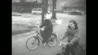 Montage Princess Beatrix wearing scarf bicycles with Princess Margriet on Beatrix's 18th birthday Beatrix smiles / rear shot the princesses ride /...