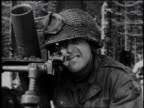Montage Soldier looking into a viewfinder / WS Two soldiers firing a mortar / Ardennes