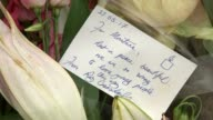 Family appeal for information ENGLAND London Kilburn EXT Bouquets of flowers at scene where Montana Abdhou shot dead Flowers and message Reiss Graham...
