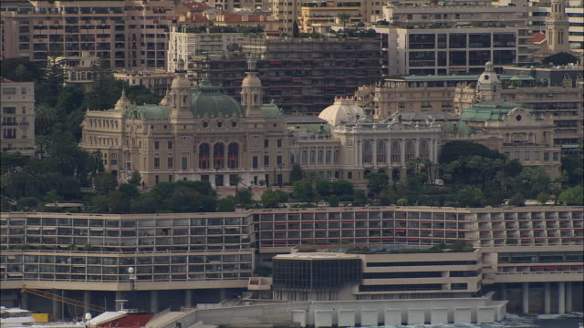 AERIAL Monte Carlo Casino with modern building just below/ Monte Carlo, France