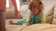 14 month old toddler boy using tablet computer