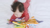 6 months baby girl reading cloth book