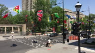 Montreal, Canada: Diverse National flags in Sherbrooke street during 'La Balade pour la Paix' event. Point of view from a tourist bus
