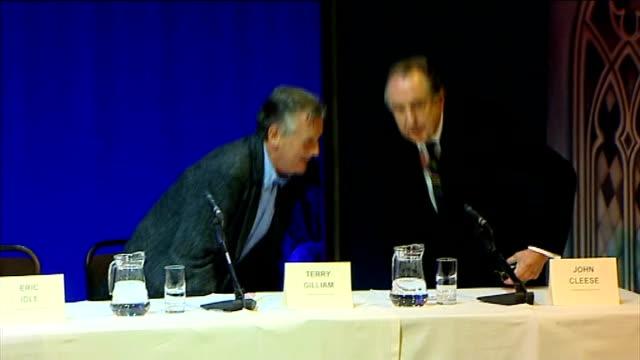 press conference announcement Monty Python members leave press conference stage to Monty Python music soundtrack SOT
