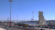 Monument to the Discoveries or Padr‹o dos Descobrimentos with the 25 de abril bridge and the tejo in the background.