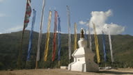 Monument with Buddhist prayer flags in different colours, Bhutan
