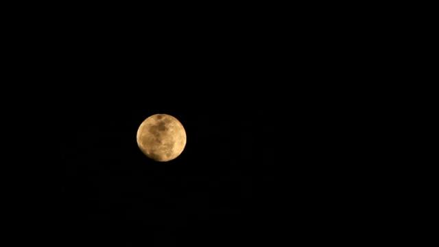 Moon on cloudy night.