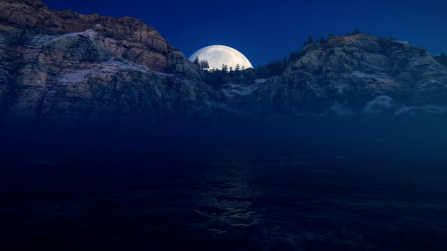 Moon over sea and mountains