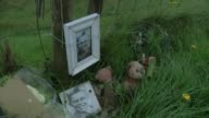 Moors Murderer Ian Brady dies aged 79 Framed photograph Keith Bennett teddy bears and flowers beside fence