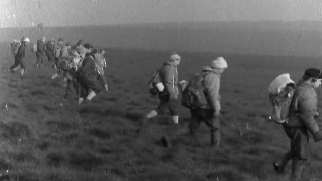 Moors Murderer Ian Brady dies aged 79 FS231065007 / TX Line of people searching the moor B/W 'Police Post Moorland Search' sign B/W Police officers...