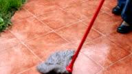 Mopping tiles in garden