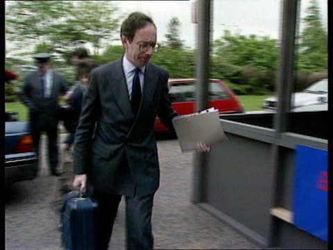 More Defence cuts ITN LIB CMS Malcolm Rifkind MP along from car towards past PAN LR to BV into building