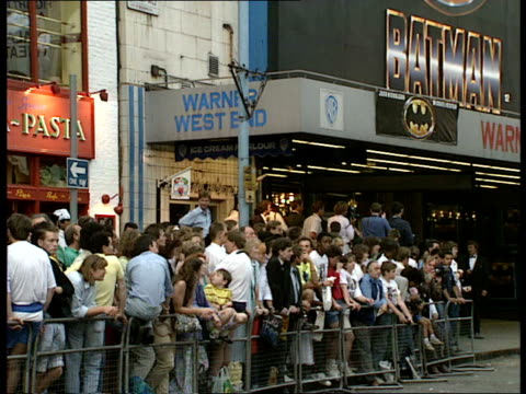 PREMIERE 'BATMAN' 17 More people buy tickets Crowds waiting outside Warner West End cinema/ Batman logo on poster above cinema/ actor Jason Connery...