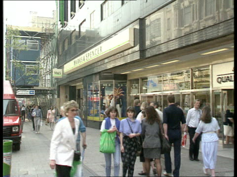 More signs of recovery LAGV Marks and Spencer branch PULL OUT INT MS Woman looking at clothes in M MS People at check out in toy shop TCMS Cash...