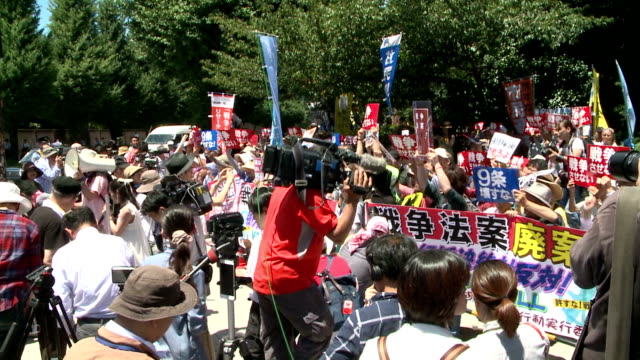 More than 1000 people gathered in front of the parliamentary building in Tokyo on July 15 to oppose the Liberal Democratic Partyled ruling...