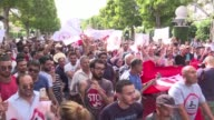 More than 1000 people protested Saturday in Tunis against a controversial amnesty law adopted by parliament for officials accused of corruption under...