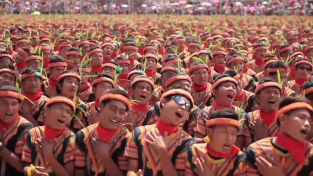 More than 10000 people turned out in Indonesias Aceh to stage a recordbreaking song and dance performance stressing the need to conserve a threatened...