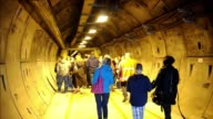 More than 1100 people signed up to walk through the service tunnesl and different parts of the Channel Tunnel which links Britain to France under the...