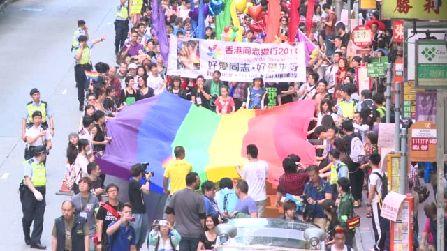 More than 2000 people march in Hong Kong's gay pride parade as campaigners call for the enactment of laws to ban discrimination against homosexuals...