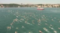 More than 2000 people take part in a yearly swimming race between Asia and Europe across the Bosphorus