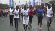 More than 20000 runners take part in the Lagos International Marathon in soaring temperatures with Kenyan runner Abraham Kiptum winning the race in 2...
