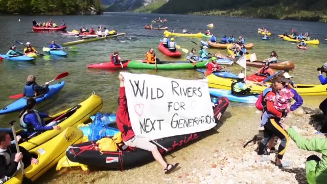 More than 60 kayakers took to Slovenias Lake Bohinj Saturday to kick off a 35 day environmental protest over plans to build dams on rivers in six...