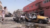 More than a dozen bombings ripped through Shiite neighbourhoods in and around Baghdad the bloodiest in a wave of attacks Wednesday that killed 49...