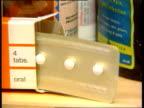 Court bid to ban sales LIB Schering PC4 morning after contraceptive pills on shelf CMS Chemist putting box of Schering pills into paper bag CMS Hands...