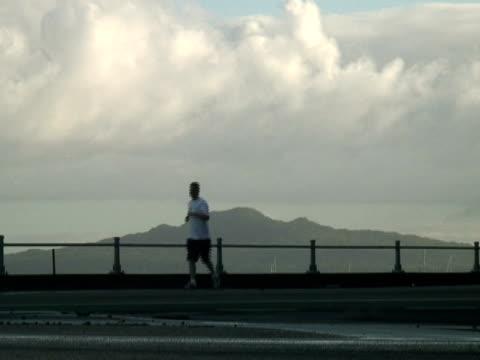 Morning Exercise: Silhouette Running to Left