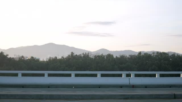 Morning on the bridge over the sea.