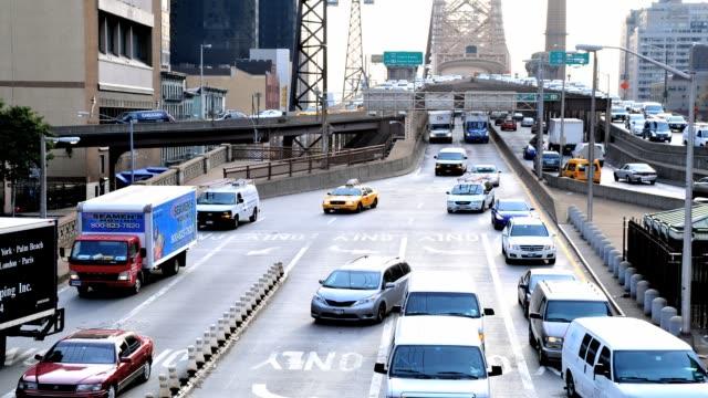 LAPSE Morning rush hour traffic on the Ed Koch Queensboro 59th Street Bridge Midtown Manhattan New York City USA TIME LAPSE Queensboro 59th Street...