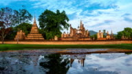 ZI, TL WS morning time of Sukhothai Historical Park, Mahathat temple reflecting in water