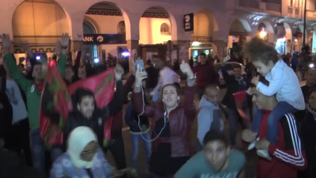 Moroccans celebrate on November 11 2017 in Rabat following Morocco's victory over Ivory Coast in their FIFA 2018 World Cup Africa Qualifier to...