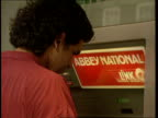 Mortgage Rate Cut EXT London CMS SIDE man at Abbey National cash machine C21049401 Baker St in wall ITN
